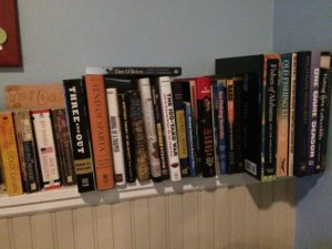 Husband's bookshelf down in the man cave.